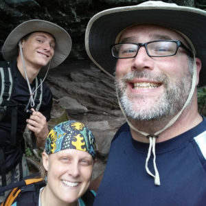 Brian, Ian , and Corinne hiking in North Carolina taking a selfie