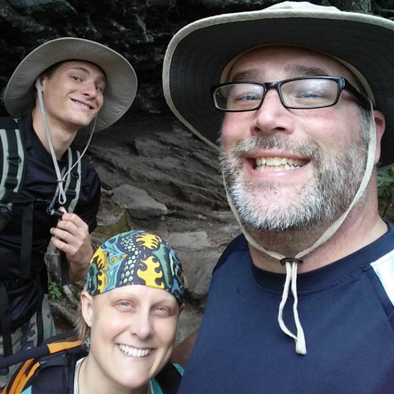 Brian, Ian , and Corinne hiking in North Carolina taking a selfie